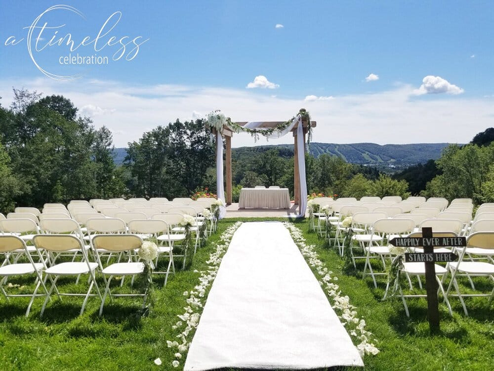 montreal outdoor wedding ceremony flowers decorations hotel spa mont gabriel