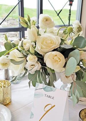 white and green wedding centerpiece flower arrangement