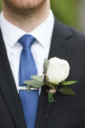 white rose boutonniere on groom