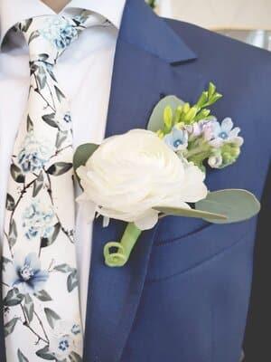 groom navy suit ranunculus blue speedia boutonniere