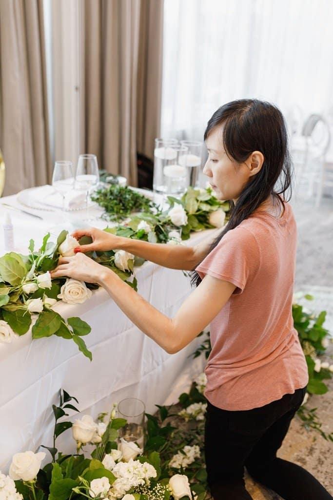 wedding floral designer setting up